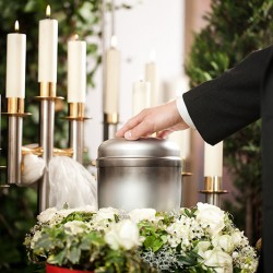 How is a body cremated?